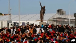 Government supporters attend a ceremony unveiling the statue of Venezuela's late president Hugo Chavez during the 17th Non-Aligned Summit, a meeting held by a Cold War-era group of 120 nations, in Porlamar on Margarita Island, Venezuela, Sept 16, 2016.