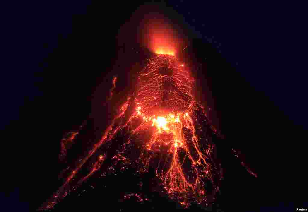 Lava flows from the crater of Mount Mayon Volcano during an eruption in Legazpi city, Albay province, south of Manila, Philippines.