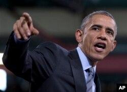 President Barack Obama speaks about immigration reform during visit to Del Sol High School in Las Vegas, Nevada, Nov. 21, 2014.