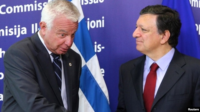 European Commission President Jose Manuel Barroso, right, welcomes Greek Prime Minister Panagiotis Pikrammenos at the European Commission headquarters in Brussels, May 23, 2012.
