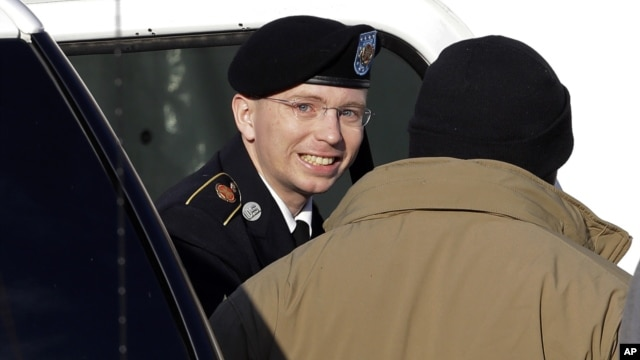 Army Pfc. Bradley Manning, center, steps out of a security vehicle as he is escorted into a courthouse in Fort Meade, Md.,  Nov. 28, 2012.