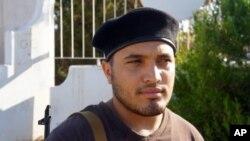 利比亞反對派支持者阿布多.卡德爾希望利比亞重新建設﹐他可以重返他電腦技術員的工作崗位。