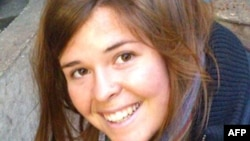 FILE - This undated handout file photo obtained Feb. 6, 2015, courtesy of the Mueller family and the office of U.S. Senator John McCain shows 26-year-old Kayla Jean Mueller.