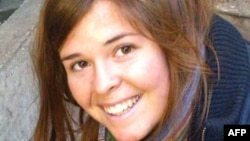 FILE - This undated handout photo shows Kayla Jean Mueller, 26. It was obtained Feb. 6, 2015, courtesy of the Mueller family and the office of U.S. Senator John McCain.