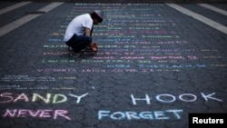 In New York City, a street artist creates a memorial for the 26 children and educators killed in the Sandy Hook Elementary School massacre. (June 14, 2013)