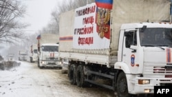 A Russian convoy transporting what Moscow said is humanitarian goods for pro-Russian separatists enters the eastern rebel-held city of Donetsk, Nov. 30, 2014.
