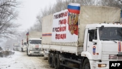 A convoy of Russian trucks, which Moscow claims is carrrying humanitarian aid, is suspected by Kyiv to be providing material support for rebels. Donetsk, eastern Ukraine, Nov. 30, 2014.