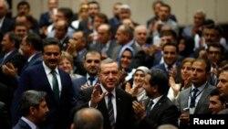 Turkey's Prime Minister Tayyip Erdogan greets ruling AK Party members, party headquarters, Ankara, June 25, 2014.