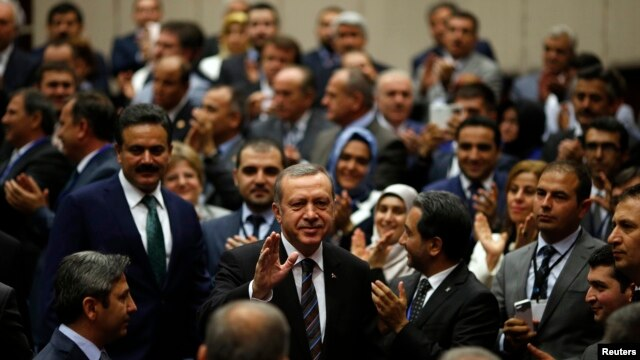 Turkey's Prime Minister Tayyip Erdogan greets ruling AK Party members, party headquarters, Ankara, June 25, 2014.