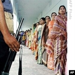 Women wait in line to vote in previous Bangladesh elections.