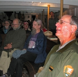 Park ranger Peter Kasin (right) leads a sea chantey sing-along aboard the 1886 sailing ship, The Balclutha.