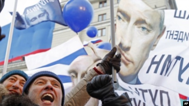 A participant gestures during a rally in support of Russian Prime Minister Vladimir Putin held close to Moscow 's Kremlin, March 5, 2012.