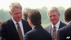 President Bill Clinton, left, and Georgia Gov. Zell Miller, right, are greeted as they arrive at the Mercer County Airport in Ewinging, New Jersey, June 4, 1996. Clinton was in New Jersey to address the 249th Commencement at Princeton University.