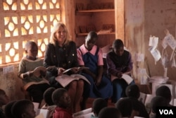 Dr. Jill Biden interacts with students at Nsama Primary School in Zomba District, Malawi, July 19, 2016. (VOA/L. Masina)