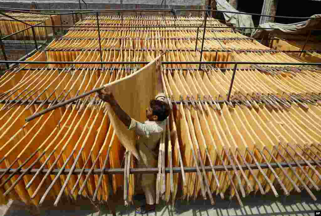 A vendor arranges traditional vermicelli noodles, a favorite during the Muslim's holy fasting month of Ramadan at a factory, in Lahore, Pakistan.