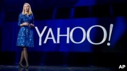 FILE - Yahoo president and CEO Marissa Mayer speaks during the International Consumer Electronics Show in Las Vegas.