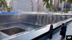 President Obama looks at the North Pool Memorial at the National September 11 Memorial in New York City.