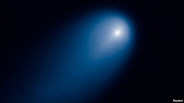 Comet ISON is shown in this NASA handout image photographed by the Hubble telescope on April 10, 2013.