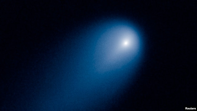Comet ISON is shown in this NASA handout photographed by the Hubble telescope, Apr. 10, 2013.
