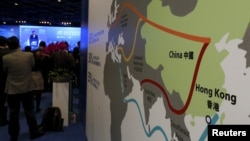 "FILE - A map illustrating China's silk road economic belt and the 21st century maritime silk road, or the so-called ""One Belt, One Road"" megaproject, is displayed at the Asian Financial Forum in Hong Kong, Jan. 18, 2016."
