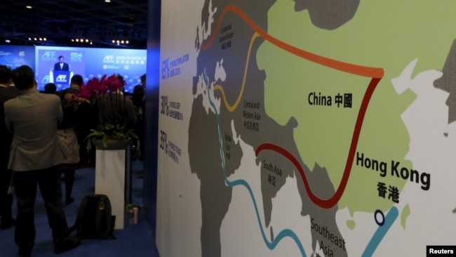 """FILE - A map illustrating China's silk road economic belt and the 21st century maritime silk road, or the so-called """"One Belt, One Road"""" megaproject, is displayed at the Asian Financial Forum in Hong Kong, Jan. 18, 2016."""