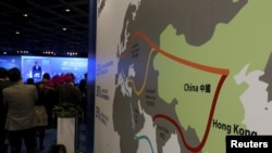 "FILE - A map illustrating China's 21st-century maritime Silk Road, or the so-called ""One Belt, One Road"" megaproject, is displayed at the Asian Financial Forum in Hong Kong, Jan. 18, 2016."