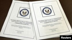 "House Intelligence Committee's report on ""national security threats posed by Chinese telecommunications companies Huawei and ZTE"" is seen at a news conference in Washington, October 8, 2012."