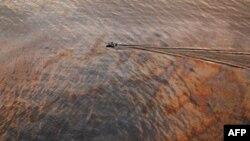 Китай подаст в суд на американскую компанию за разлив нефти
