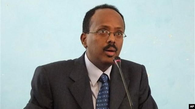 Somali Prime Minister Mohamed Abdullahi Mohamed after his swearing-in ceremony at the Presidential residence in Mogadishu, Somalia. Monday Nov. 1, 2010