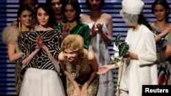 Gulnara Karimova ( C), daughter of Uzbekistan's President Islam Karimov, acknowledges the audience after her Collection at China Fashion Week in Beijing October 30, 2012. (REUTERS/Jason Lee)