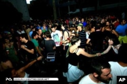 Partygoers at a club in Barcelona rave to the sounds of DJ Culoe De Song, who studied at the Spanish city's famous Red Bull Music Academy