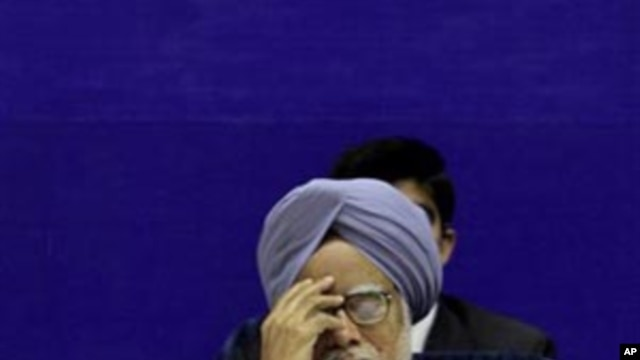Indian Prime Minister Manmohan Singh gestures during a conference in New Delhi (file photo - February16, 2011)