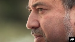 Israel's Foreign Minister Avigdor Lieberman looks on prior to his meeting with European Union foreign policy chief Catherine Ashton, not seen, in Jerusalem, Feb 15, 2011