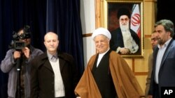 FILE - Former Iranian President Akbar Hashemi Rafsanjani, center, arrives for a press briefing after registering his candidacy for the Feb. 26 elections of the assembly at interior ministry in Tehran, Iran, Dec. 21, 2015.