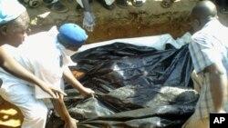 Workers bury victims of Boko Haram.