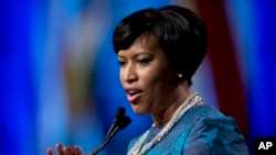 FILE - Washington Mayor Muriel Bowser, shown after taking the oath of office last month, defied a lawmaker's threat that she and other city leaders could face prison time for implementing a voter-approved marijuana law.