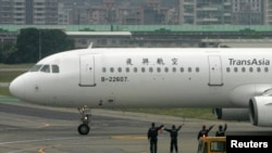 FILE - TransAsia Airways plane at Taipei, Taiwan airport.