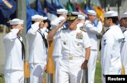 Vice Admiral Robert S. Harward, commander of Combined Joint Task Force 435, salutes during a SEAL Team 5 change of command ceremony in San Diego, California, July 11, 2011.