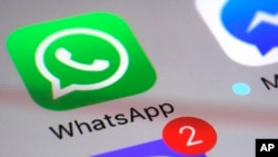 The WhatsApp icon, as seen on a smartphone.