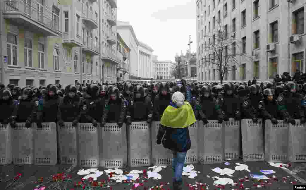 Riot police and Interior Ministry personnel block a street during a rally organized by supporters of EU integration in central Kyiv, Ukraine.