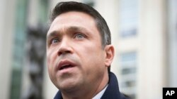 FILE - Rep. Michael Grimm speaks to reporters outside federal court in Brooklyn after pleading guilty to a federal tax evasion charge rather than go to trial, in New York, Dec. 23, 2014.