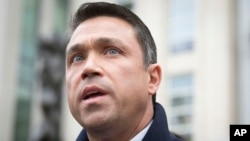 Rep. Michael Grimm speaks to the media outside Federal court in Brooklyn after pleading guilty to a federal tax evasion charge rather than go to trial, in New York, Dec. 23, 2014.
