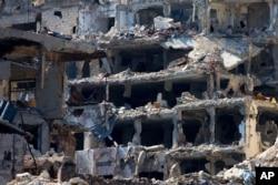 Các tòa nhà bị phá hủy trong các vụ không kích tại thành phố Homs, ngày 26/2/2016.