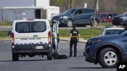 Policija blizu mesta pucnjave u Frederiku, u Merilendu (Foto: AP/Julio Cortez)