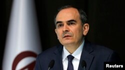 FILE - Turkey's Central Bank Governor Erdem Basci addresses the media in Ankara, Jan. 28, 2014.