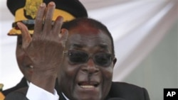 FILE- In this Sunday, March, 27, 2011, file photo, Zimbabwean President Robert Mugabe addresses mourners at a state funeral in Harare. According to South African ruling party African National Congress (ANC) mediators who are negotiating constitutional r