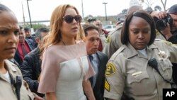 FILE - Actress Lindsay Lohan arrives at the Los Angeles Superior court.