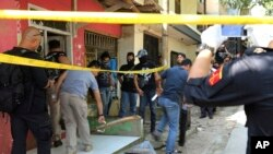 Hiện trường một vụ tấn công ở Indonesia hồi tháng Năm.