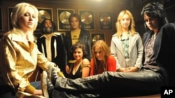 "From left to right: Dakota Fanning, Mickey Petralia, Michael Shannon, Alia Shawkat, Scout Taylor-Compton, Stella Maeve and Kristen Stewart in ""The Runaways"""