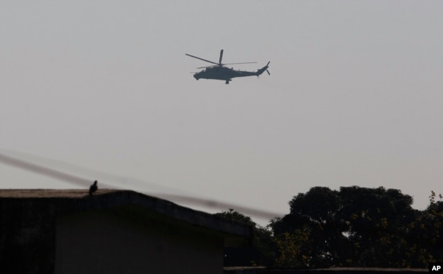 An Indian air force chopper on a reconnaissance mission flies over the Indian airbase in Pathankot, 430 kilometers (267 miles) north of New Delhi, India, Jan. 2, 2016.